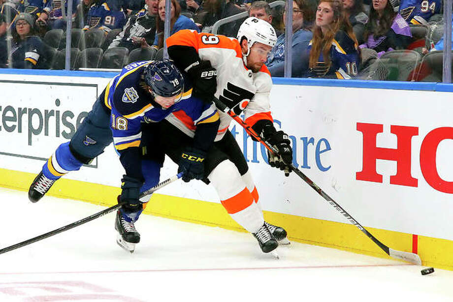 Philadelphia's defenseman Ivan Provorov (9) beats Blues center Robert Thomas (18) to the puck during the second period of a Wednesday night's game in St. Louis. Photo: AP Photo