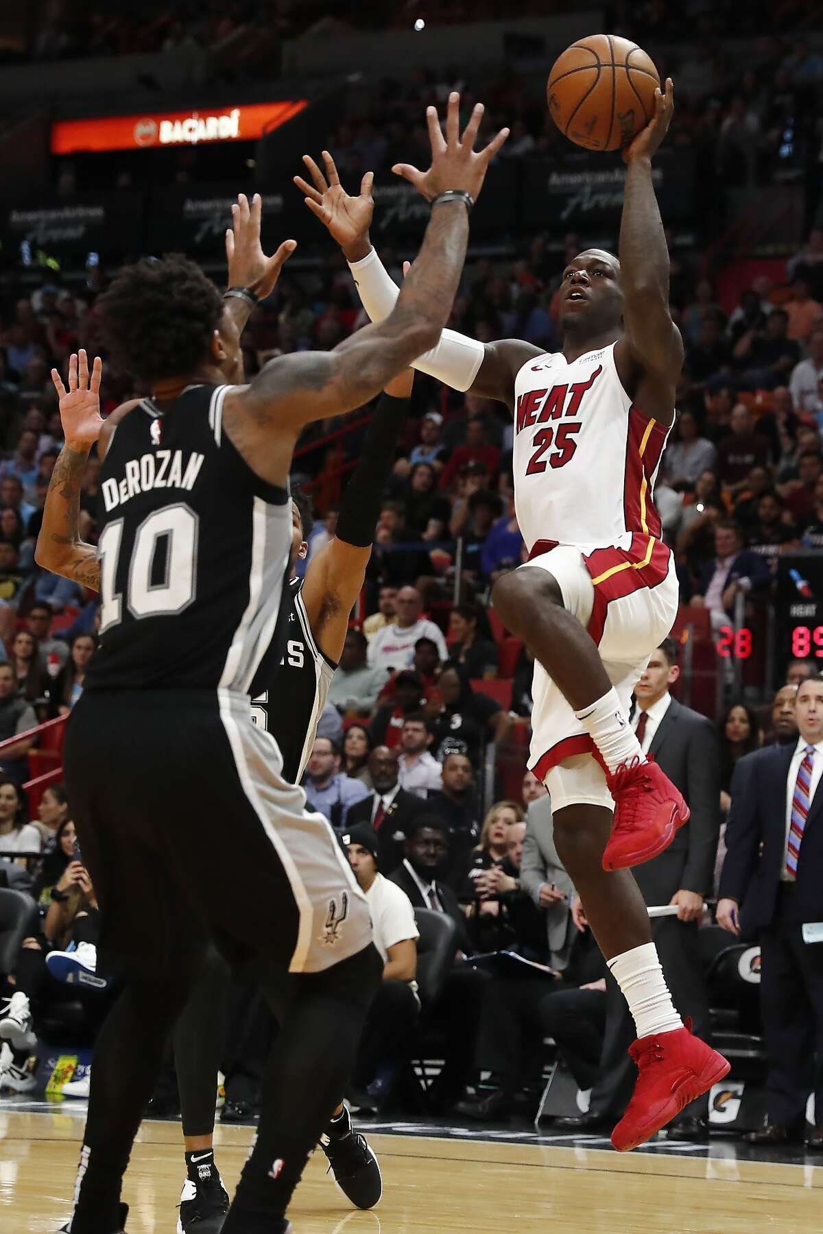 Miami Heat guard Kendrick Nunn (25) shoots the ball against San Antonio Spurs guard DeMar DeRozan (10) in the second half of an NBA basketball game, Wednesday, Jan. 15, 2020, in Miami. (AP Photo/Brynn Anderson)
