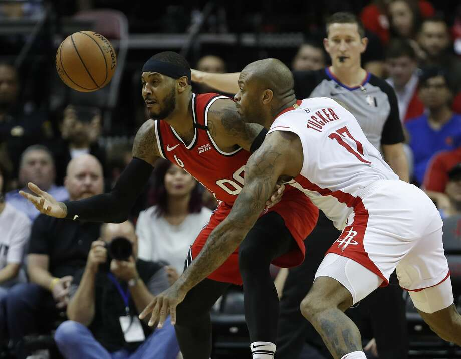 P.J. Tucker and the Rockets will visit old friend Carmelo Anthony and the Trail Blazers in Portland looking to avenge a home-court loss two weeks ago. Photo: Karen Warren/Staff Photographer