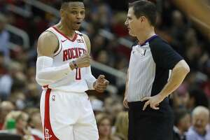 Houston Rockets guard Russell Westbrook (0) talks with referee David Guthrie (16) in the first half of an NBA basketball game at Toyota Center, in Houston, Wednesday, Jan. 15, 2020.