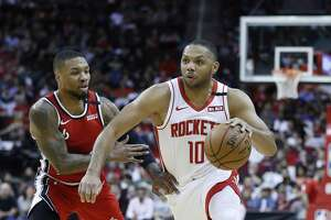 Houston Rockets guard Eric Gordon (10) works around Portland Trail Blazers guard Damian Lillard (0) in the first half of an NBA basketball game at Toyota Center, in Houston, Wednesday, Jan. 15, 2020.