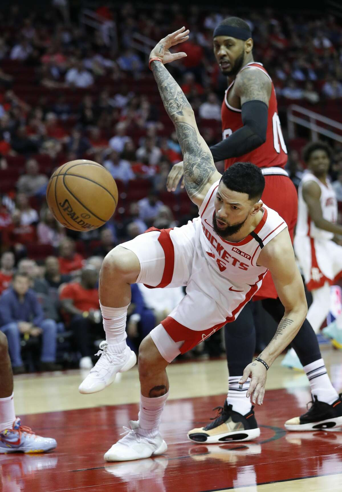 Houston Rockets guard Austin Rivers (25) falls after going up for a basket against Portland Trail Blazers forward Carmelo Anthony (00) in the second half of an NBA basketball game at Toyota Center, in Houston, Wednesday, Jan. 15, 2020.