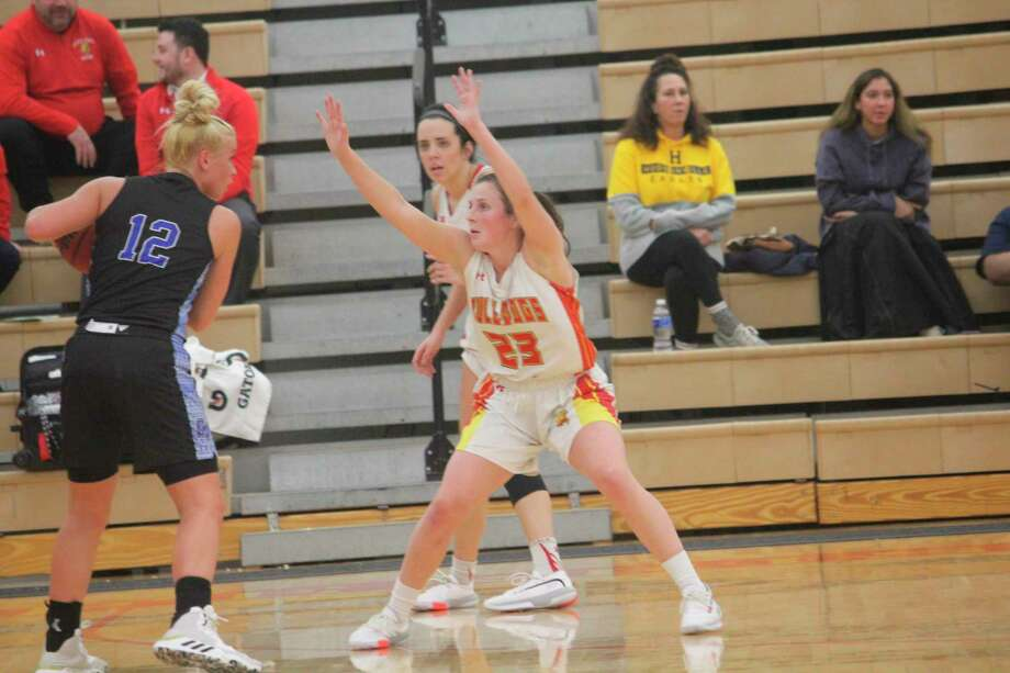 Mallory McCartney (23) and teammate Riley Blair (back) focus on defense for Ferris in recent action. (Pioneer photo file)