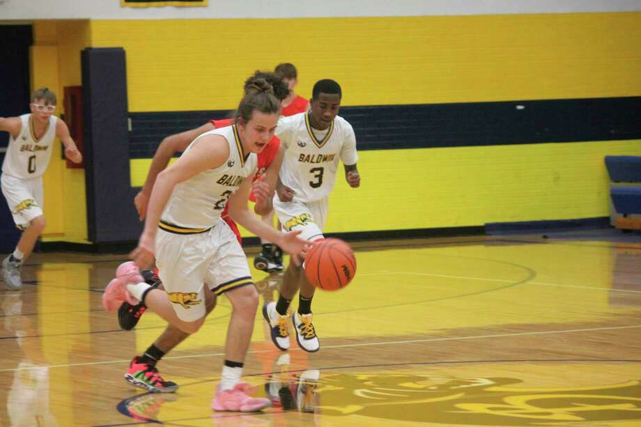 Baldwin's Dexter Hossler heads to the basket during recent action. (Star photo/John Raffel)