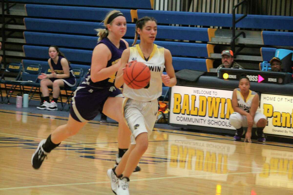 Monique Rowland takes the ball to the basket for Baldwin's JV team in recent action. (Star photo/John Raffel)