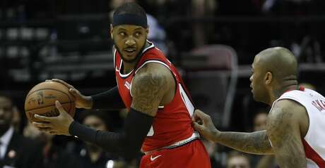 Portland Trail Blazers forward Carmelo Anthony (00) battles against Houston Rockets forward PJ Tucker (17) in the first half of an NBA basketball game at Toyota Center, in Houston, Wednesday, Jan. 15, 2020.