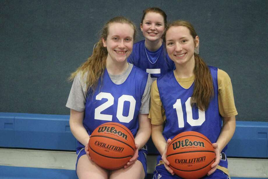 The trio of Keeleigh Wilbanks (back), Jenna Patteson (20) and Brenna Fuller (10) were responsible for 50 percent of Tuesday night's points. The club will try to make it 2-0 for district road assignments come Friday night. Photo: Robert Avery