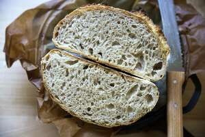A halved loaf of sourdough bread, made with wheat flour and an active starter. (Provided)