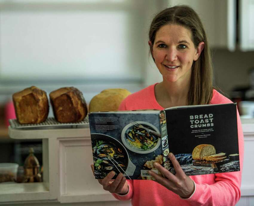 Local food blogger/writer Alexandra Stafford shows her new book at her home Wednesday May 31, 2017 in Niskayuna, N.Y. (Skip Dickstein/Times Union)