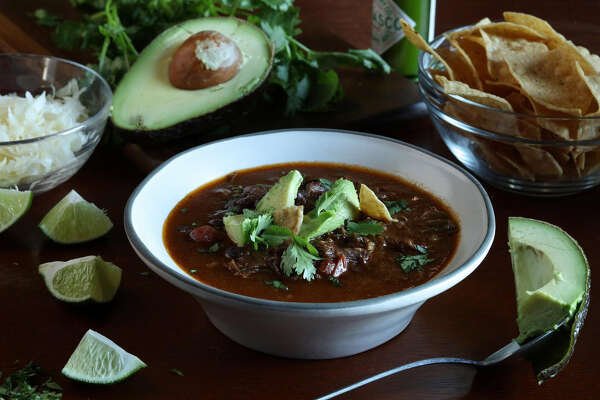 Short rib and flank steak soup sports all the luscious flavors of beefy tacos, but can be made ahead and eaten out of a bowl. (Abel Uribe/Chicago Tribune/TNS)