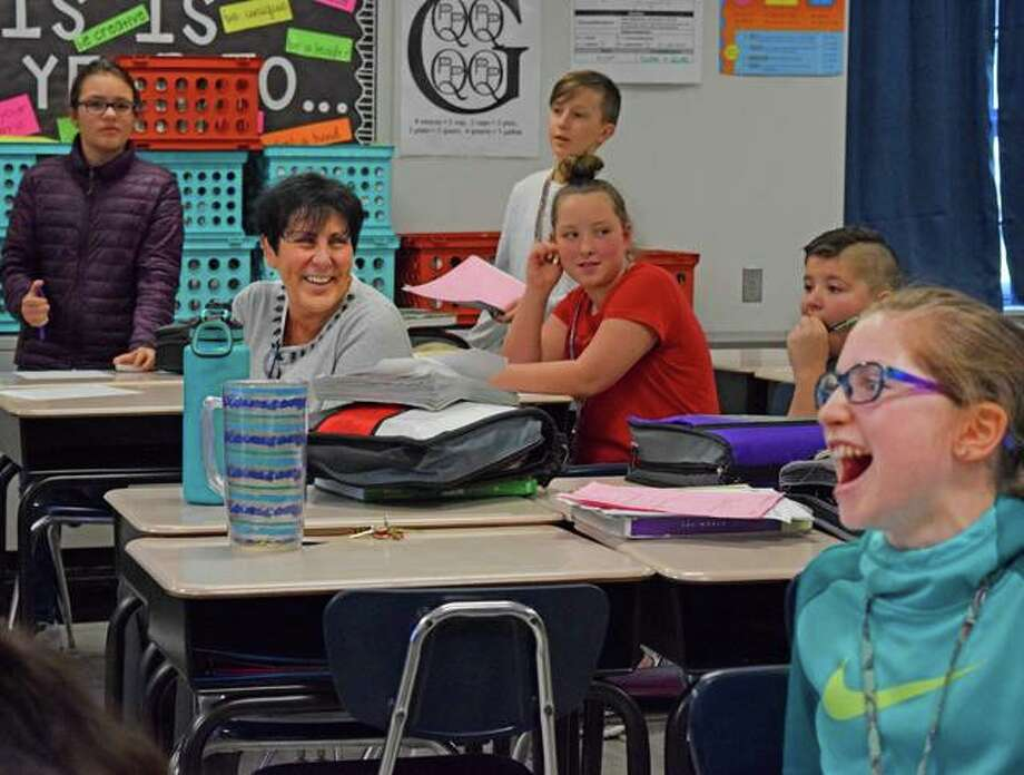 Liberty Middle School Principal Beth Crumbacher smiles as she watches students participate in an educational game on Wednesday during their seventh-period math class. Photo: Tyler Pletsch | The Intelligencer