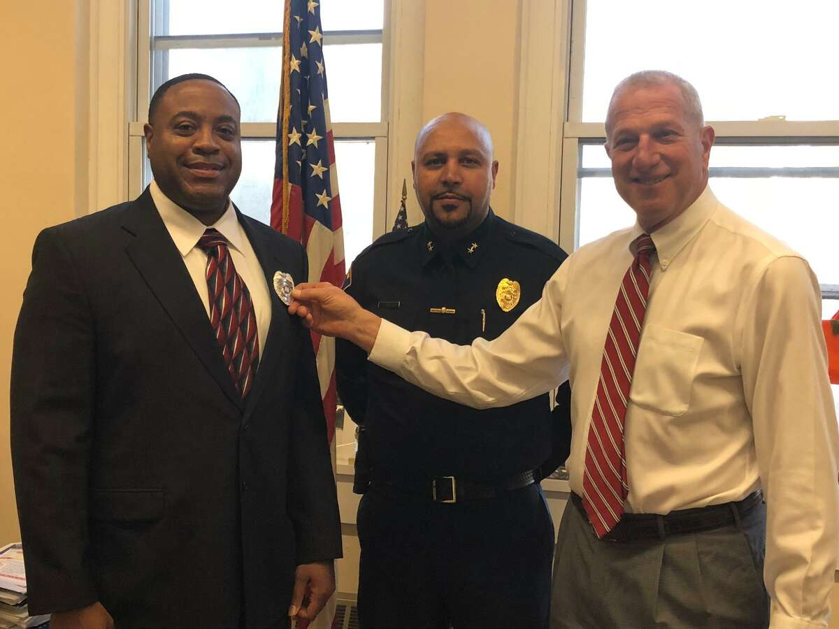 Shelton Police Officer John Staples Jr., left, with Mayor Mark Lauretti, right, and Police Chief Shawn Sequeira at his swearing in last January, is heading up the department's new crime prevention and neighborhood watch program.