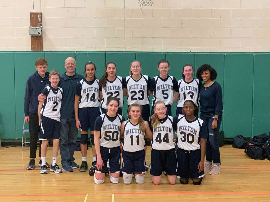The Wilton 8th grade girls basketball team split two games last weekend. Photo: Contributed Photo / Wilton Basketball Association