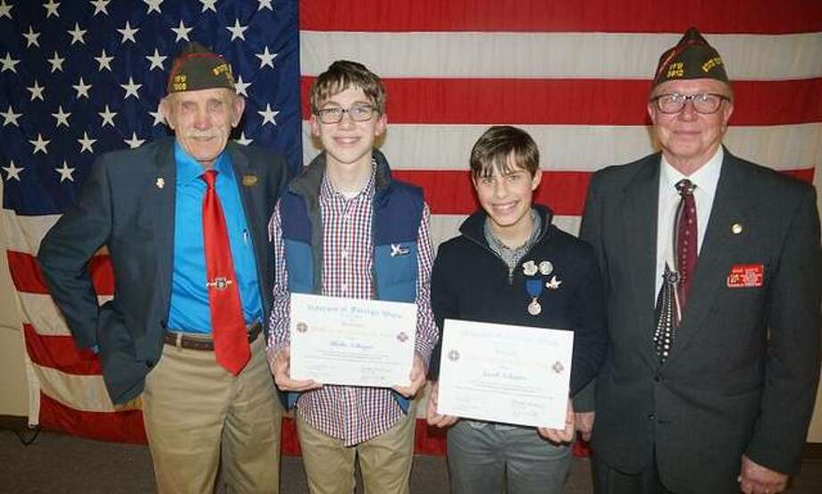 Pictured from left are Dave Stout, Illinois VFW Commander; Blake Schaper, 13, 2nd Place Patriot's Pen Essay Winner; Jacob Schaper, 14, 1st Place Patriot's Pen Essay Winner; and Dave Darte, VFW Assistant Youth Activities/Scouting Director.