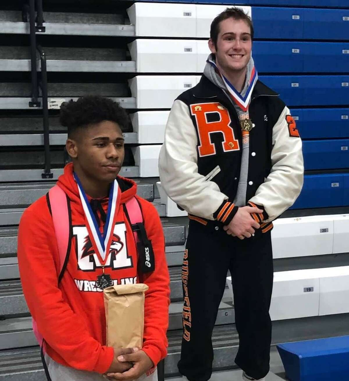 Ridgefield's Liam Keppler, right, won his weight class at the Greater Hartford Open wrestling tournament.