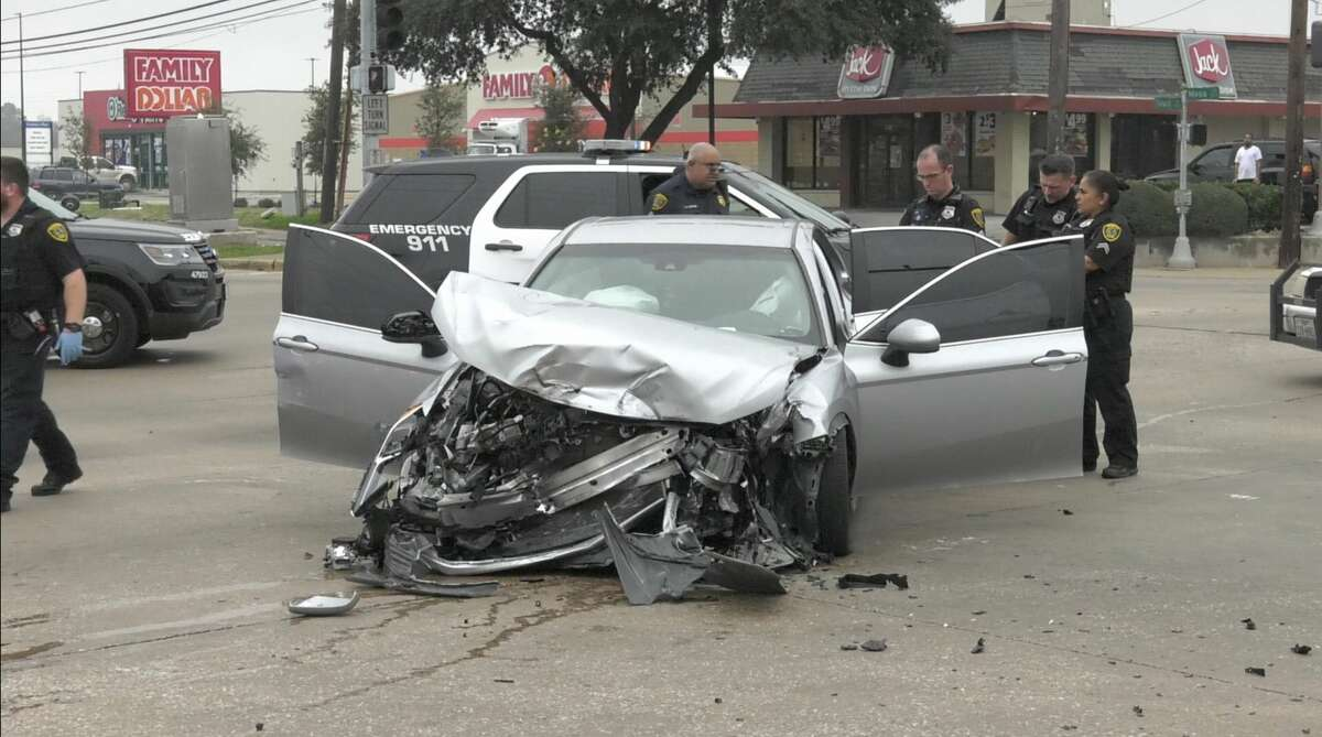 Houston police officers work the scene of a 120 mph pursuit that ended in a violent crash at Tidwell and Mesa on Thursday, Jan. 16, 2020.