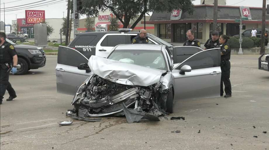 Houston police officers work the scene of a 120 mph pursuit that ended in a violent crash at Tidwell and Mesa on Thursday, Jan. 16, 2020. Photo: Jay R. Jordan / Houston Chronicle