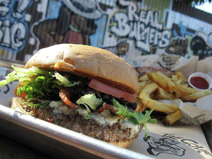 The Blue Bison burger incorporates a grilled bison patty, blue cheese, bacon and chipotle mayo at The Cove.