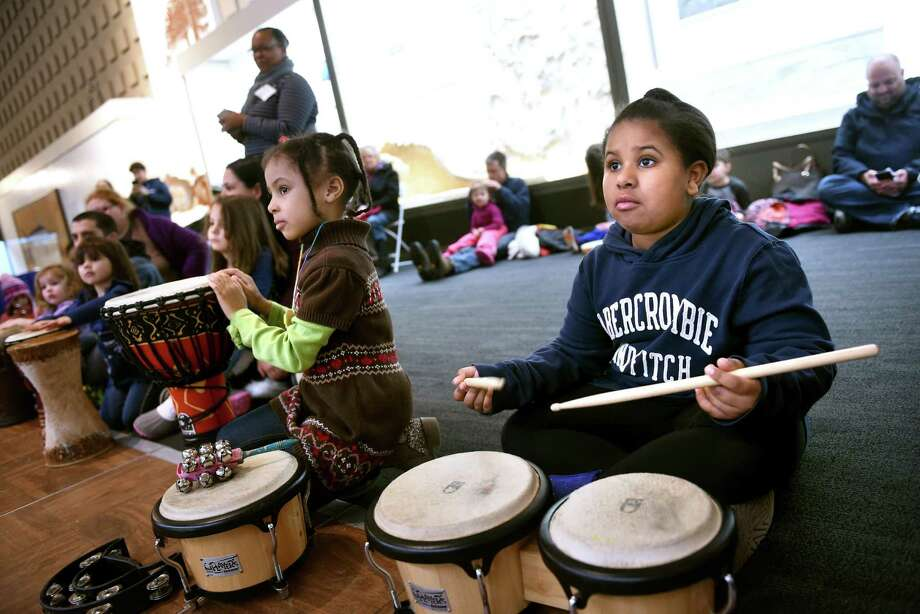 Graysen Beck (left), 6, and her sister, Scotland (right), 8, of Hamden take part in a drum circle lead by Gammy Moses during the 23rd Annual Dr. Martin Luther King, Jr.'s Legacy of Environmental and Social Justice event at the Yale Peabody Museum of Natural History in New Haven on January 20, 2019. Photo: Arnold Gold / Hearst Connecticut Media / New Haven Register