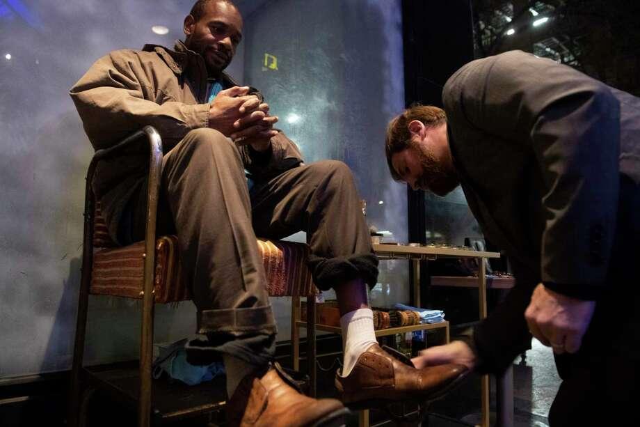 Craig Berkenkamp shines Cornelius Wheeler's shoes at the street level entrance of the Jet Setter bar downtown San Antonio. Berkenkamp's story stirred  nostalgia  in one reader. Photo: Carlos Javier Sanchez /Contributor / Carlos Javier Sanchez