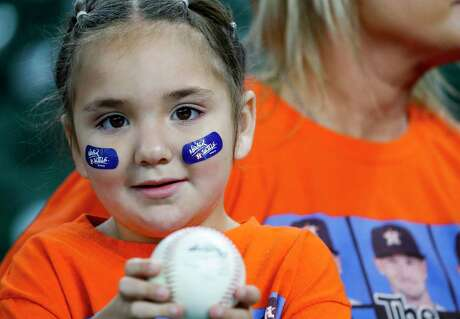Lilliana Cardoza waits for an autograph before Game 5 of the American League Championship Series at Minute Maid Park on Thursday, Oct. 18, 2018, in Houston.