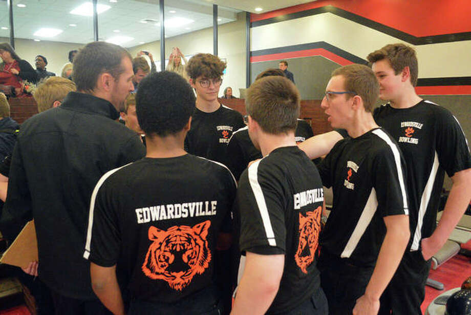 Edwardsville boys bowling coach Craig Ohlau, left, talks to his team after a Southwestern Conference match against Belleville East on Jan. 6 at Cougar Lanes at SIUE. Photo: Scott Marion/The Intelligencer