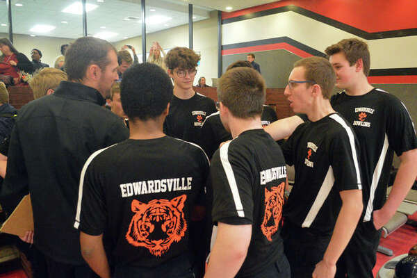 Edwardsville boys bowling coach Craig Ohlau, left, talks to his team after a Southwestern Conference match against Belleville East on Jan. 6 at Cougar Lanes at SIUE.