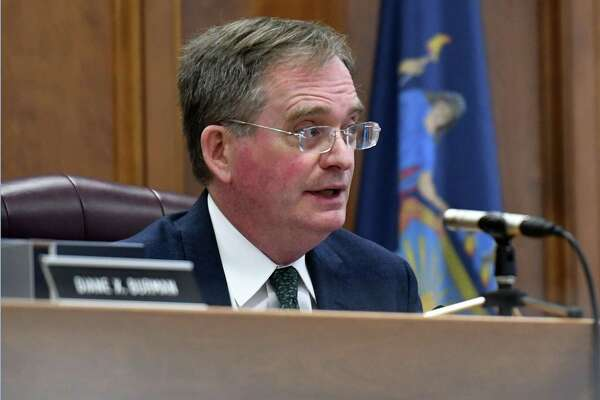 Public Service Commission chair John Rhodes presides over a PSC meeting where Con Edison electric and gas hikes were approved on Thursday, Jan. 16, 2020, at Empire State Plaza Agency Building 3 in Albany, N.Y. (Will Waldron/Times Union)