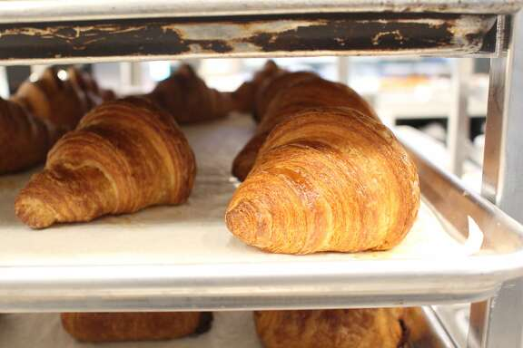 Trays of freshly baked croissants sit at Arsicault, 87 McAllister St., San Francisco.