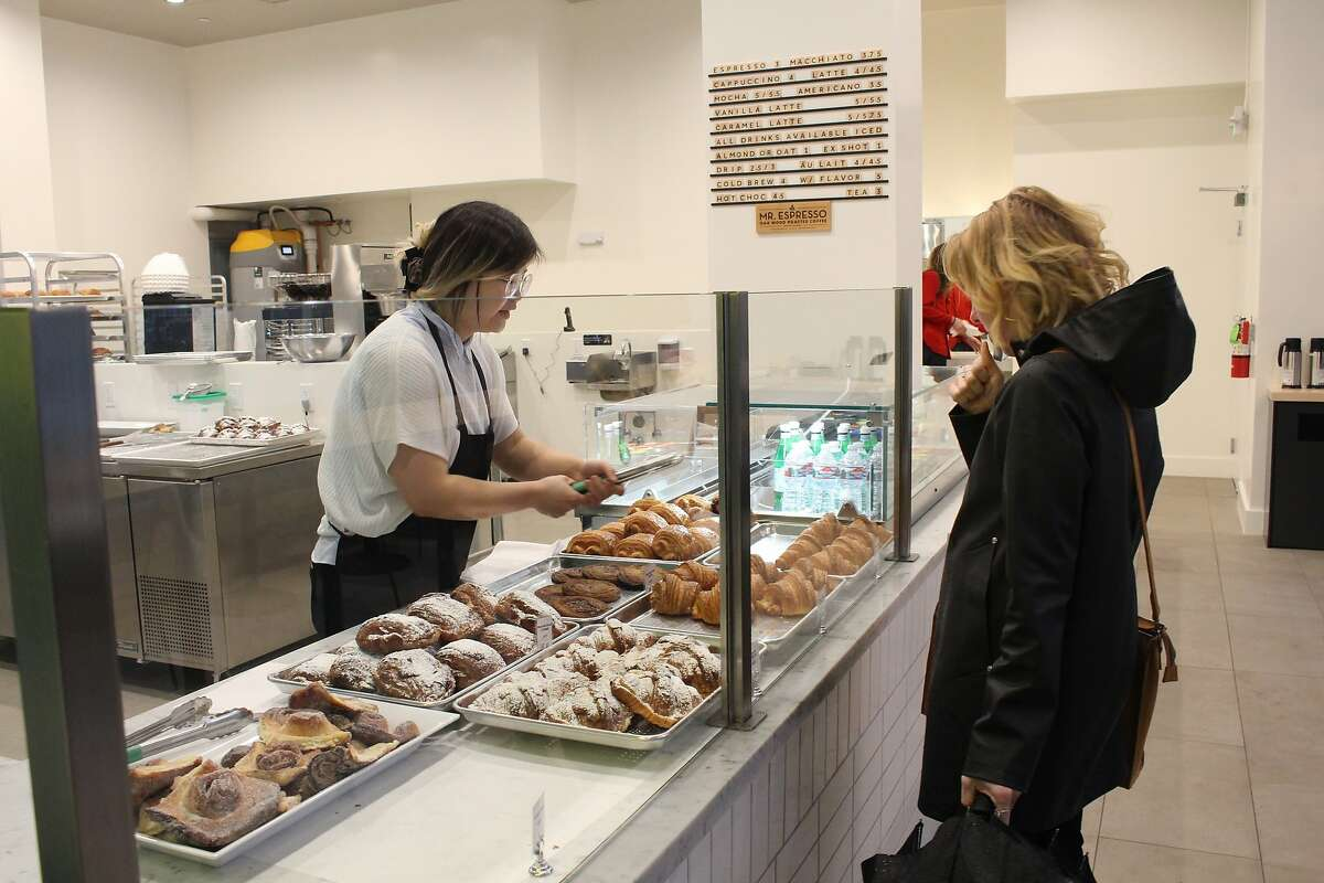 A customer chooses between croissants at Arsicault, 87 McAllister St., San Francisco.