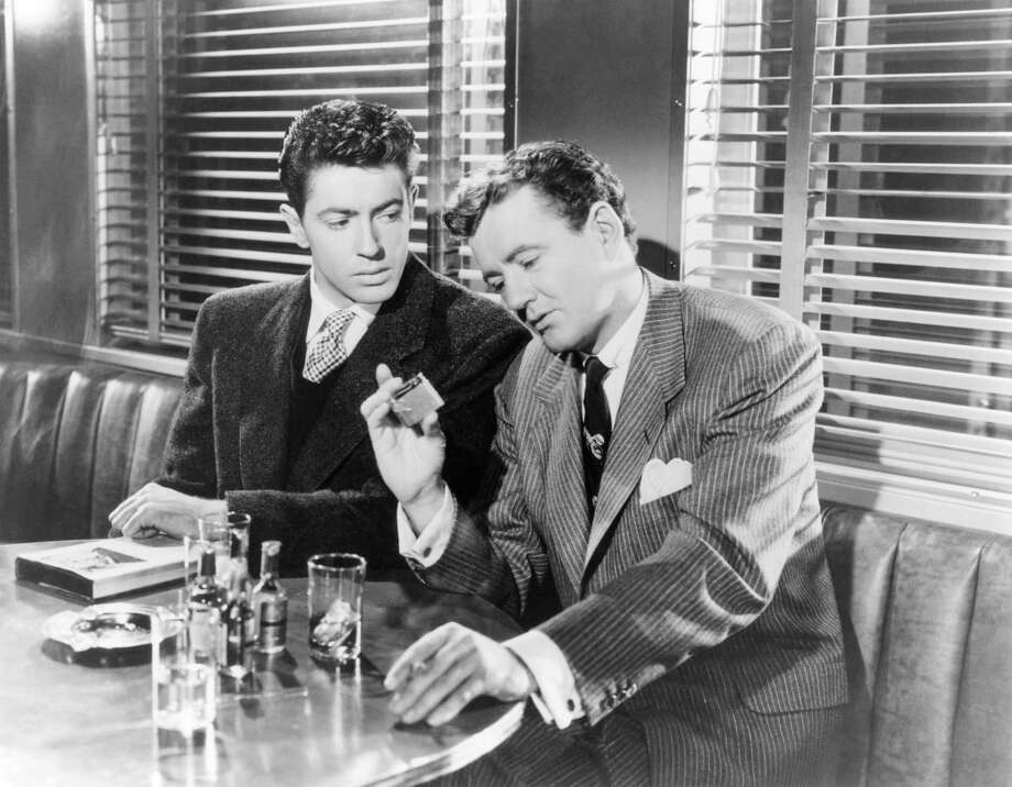 """Actors Farley Granger, left, and Robert Walker on the set of """"Strangers on a Train,"""" directed and produced by Alfred Hitchcock. The Byram Shubert Library in Greenwich will host a showing of the classic film Jan. 18. Photo: Corbis / Getty Images / Corbis Historical"""