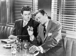 "Actors Farley Granger, left, and Robert Walker on the set of ""Strangers on a Train,"" directed and produced by Alfred Hitchcock. The Byram Shubert Library in Greenwich will host a showing of the classic film Jan. 18."