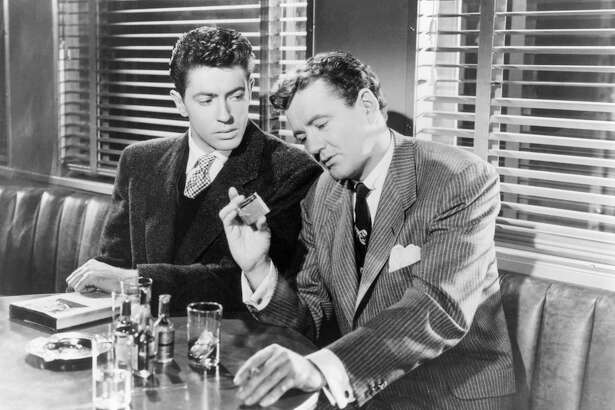 """Actors Farley Granger, left, and Robert Walker on the set of """"Strangers on a Train,"""" directed and produced by Alfred Hitchcock. The Byram Shubert Library in Greenwich will host a showing of the classic film Jan. 18."""