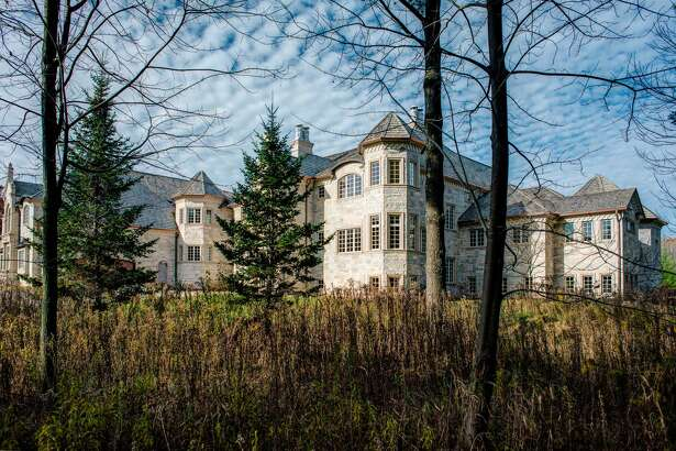 This stone, French-style chateau with three levels, eight bedrooms, seven full baths and three half baths, with 27,699 square feet on approximately 2.73 acres of land in Oneida, WI is up for auction next month. It's also the house next to football star Aaron Rogers.