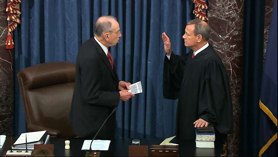 In this image from video, President Pro Tempore of the Senate Sen. Chuck Grassley, R-Iowa., swears in Supreme Court Chief Justice John Roberts as the presiding officer for the impeachment trial of President Donald Trump in the Senate at the U.S. Capitol in Washington, Thursday, Jan. 16, 2020. (Senate Television via AP) Photo: Senate Television