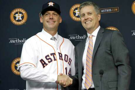 Houston Astros general manager Jeff Luhnow, right, and A.J. Hinch pose after Hinch is introduced as the new manager of the baseball club in Houston on Sept. 29, 2014 Hinch and Luhnow were fired Monday, Jan. 13, 2020, after being suspended for their roles in the team's extensive sign-stealing scheme from 2017.