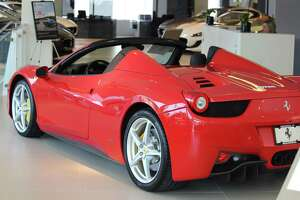 "San Antonio residents Ryad and Diana Bakalem allege in a lawsuit that an employee of the Ferrari of San Antonio dealership on Nov. 25 was allowed take their 2014 Ferrari 458 Spider — similar to the one pictured — to ""'hot-rod' around town."" The vehicle was ""wrecked and totaled."""