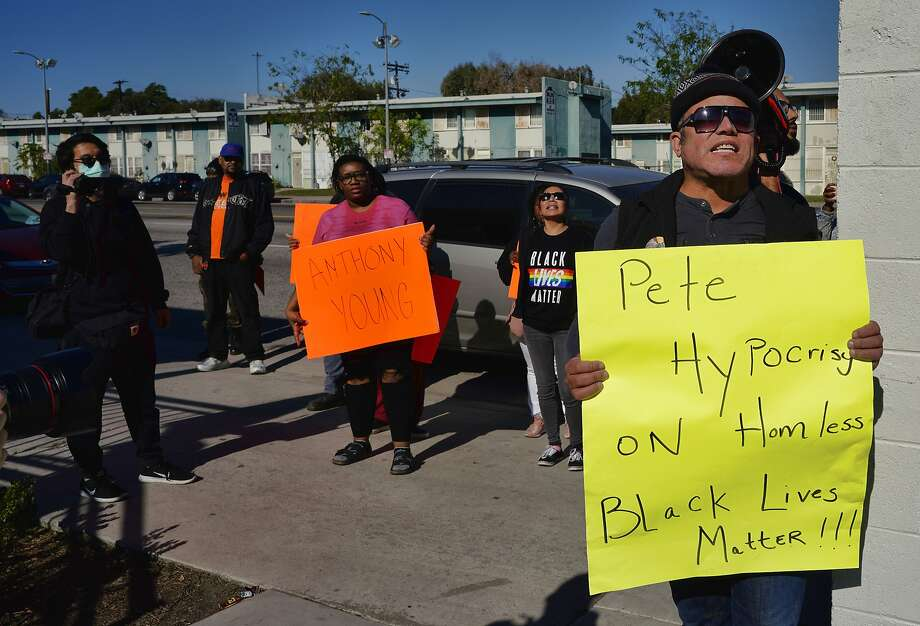 Black Lives Matter activists protest former South Bend, Ind. Mayor Pete Buttigieg at a recent campaign stop in Los Angeles, spurred in part by his firing of south Bend's first black police chief in 2012. Photo: Richard Vogel / Associated Press