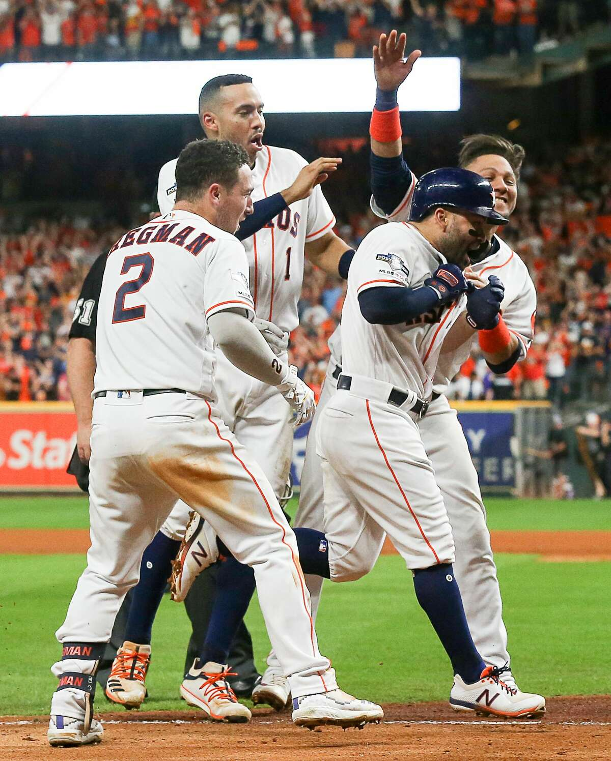 Jose Altuve bobbling his finger after crushing a game-winning homer to clinch the American League championship against the New York Yankees in 2019. The second baseman was wagging his finger to his teammates, telling them to not rip off his shirt and reveal a personal tattoo of his wife's name.