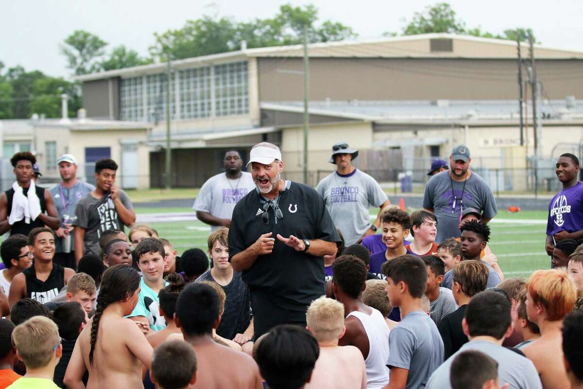 Jeff Nations, head football coach and athletic director for Dayton ISD, has the students cracking up at some of his instructions including getting off the X-Box, doing some workouts, and playing some yard ball.