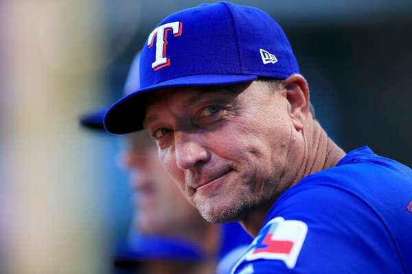 ARLINGTON, TX - AUGUST 29: Manager Jeff Banister #28 of the Texas Rangers looks on from the dugout as the Texas Rangers prepare to take on the Los Angeles Dodgers at Globe Life Park in Arlington on August 29, 2018 in Arlington, Texas. (Photo by Tom Pennington/Getty Images)