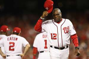 WASHINGTON, DC - OCTOBER 06: Dusty Baker #12 of the Washington Nationals tips his cap prior to game one of the National League Division Series at Nationals Park on October 6, 2017 in Washington, DC. (Photo by Patrick Smith/Getty Images)