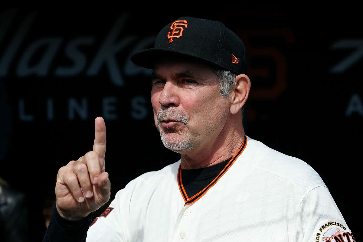 FILE - Manager Bruce Bochy #15 of the San Francisco Giants looks on from the dugout before his last game as Giants manager, the game against the Los Angeles Dodgers at Oracle Park on September 29, 2019 in San Francisco, California.