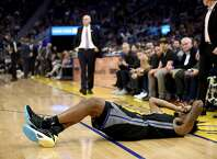 SAN FRANCISCO, CALIFORNIA - JANUARY 14:  Jacob Evans III #10 of the Golden State Warriors lies on the court after being injured during their game against the Dallas Mavericks at Chase Center on January 14, 2020 in San Francisco, California. NOTE TO USER: User expressly acknowledges and agrees that, by downloading and or using this photograph, User is consenting to the terms and conditions of the Getty Images License Agreement.  (Photo by Ezra Shaw/Getty Images)