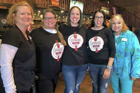 Cypress Area Eats founders Metta Archilla, Lauren Giurlanda and Nancy Eugenio pose with Patricia Hudson,executive director of community outreach forCy-Fair Helping Hands.