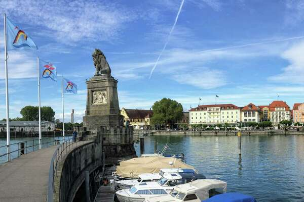 The harbor at Lindau, with lighthouse and lion statue.