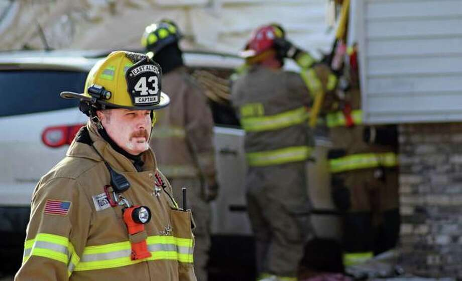 Scenes from a structure fire in Wood River that required assistance from five different area fire departments. Photo: Tyler Pletsch | The Intelligencer