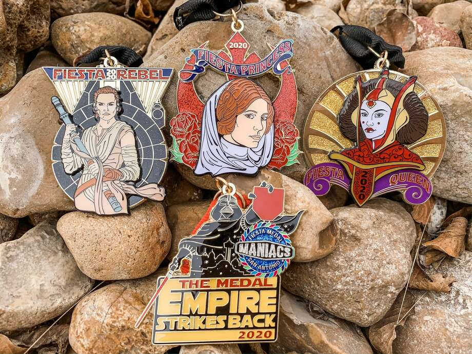 Fiesta Medal Maniacs, an organization run by three passionate Fiesta-loving women, unveiled its four-pack Star Wars-themed medals Wednesday at its event at the Brick at Blue Star Arts Complex. Photo: Maggie Ibarra-Jimenez
