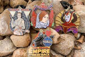 Fiesta Medal Maniacs, an organization run by three passionate Fiesta-loving women, unveiled its four-pack Star Wars-themed medals Wednesday at its event at the Brick at Blue Star Arts Complex.