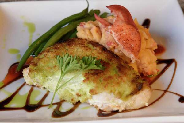 Baked Block Island swordfish - basil souffle, lobster mashed potato, haricot verts, red pepper coulis, balsamic reduction at Fish at 30 Lake located at the Pavilion Grand hotel on Wednesday, Jan. 8, 2020 in Saratoga Springs, N.Y. (Lori Van Buren/Times Union)